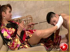 Japanese newhalf Reina blows smoke in her submissi...